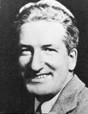 Black and White photo of author Frank Scully smiling