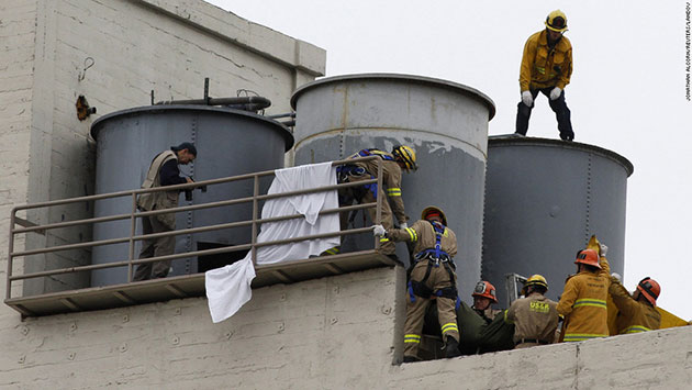 Firemen removing Elisa Lam's body from the water towers