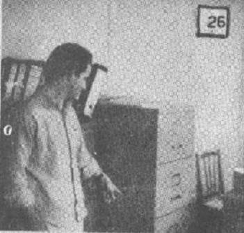 Engineer Benedito Clóvis dos Santos pointing to the file that showed signs of strange activities